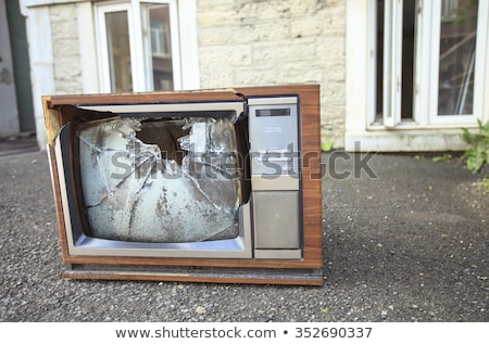 An old broken TV left on the street. Stock photo © Lopolo