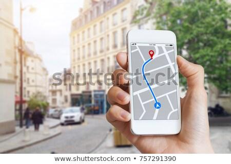 Személy GPS navigáció térkép mobiltelefon közelkép Stock fotó © AndreyPopov