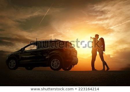 loving couple outdoors at beach near car stock photo © deandrobot