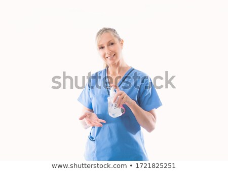 Nurse holding and demonstrating hand hygiene alcohol rub Stock photo © lovleah