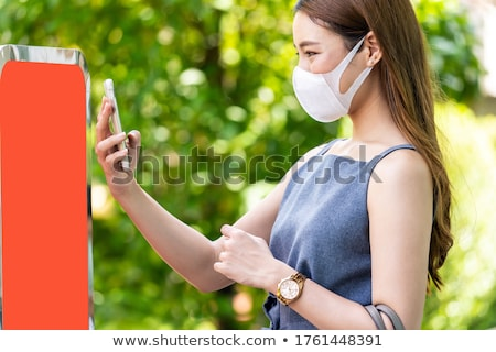 Asian woman scaning online queue for restaurant. Stock photo © vichie81
