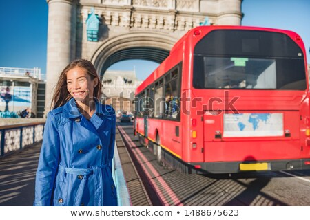 London woman walking commute on Tower Bridge city street using public transport bus commuting in the Stock photo © Maridav