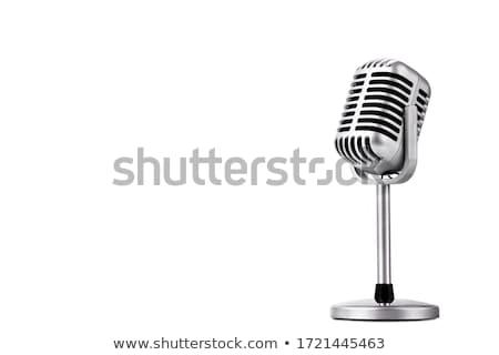 mikrofon · áll · narancs · színpad · fények · zene - stock fotó © pressmaster