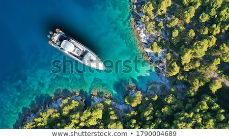 boat and island stock photo © timbrk