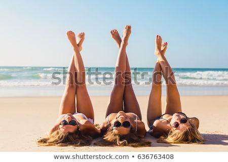Smiling bikini beach girl looking up Stock photo © lovleah