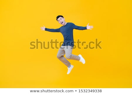 boy jumpging arms outstretched Stock photo © lovleah