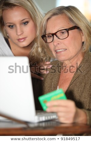mother and daughter calculating social security stock photo © photography33