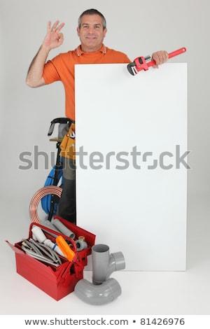 Vízvezetékszerelő ok felirat mögött fal mosoly Stock fotó © photography33