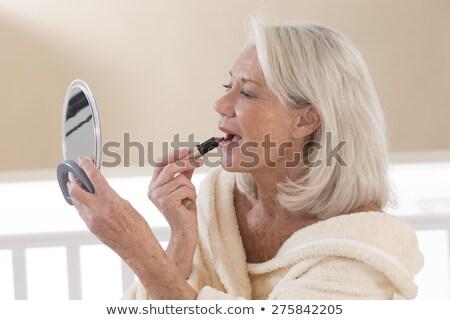 Nő jelentkezik smink idősebb hölgy család Stock fotó © photography33