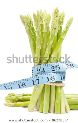 lose weight concept asparagus with tape stock photo © ansonstock