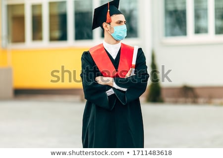 Studenten tragen zeremoniellen Kleid Augen Haar Stock foto © photography33