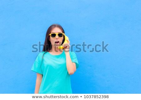 Dom telefoon meisje mooie vrouw grappig gezichten Stockfoto © iko
