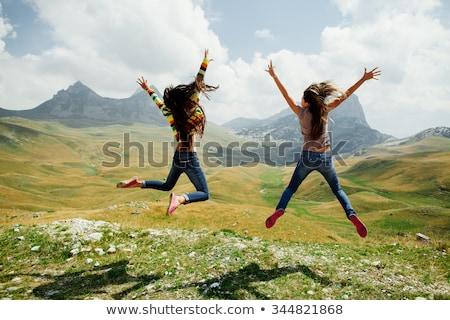 Skok dziewczyna włosy niebo real kobieta Zdjęcia stock © Paha_L