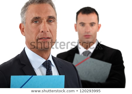 Portrait of a businessman with his assistant trailing behind him Stock photo © photography33