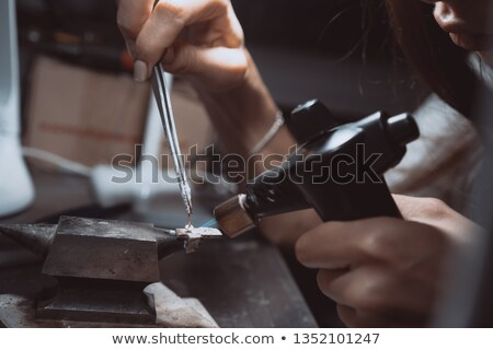 Woman with a blowtorch stock photo © photography33