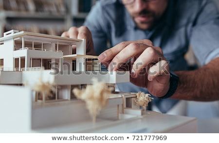 Férfi építész tart modell lakásügy építkezés Stock fotó © photography33