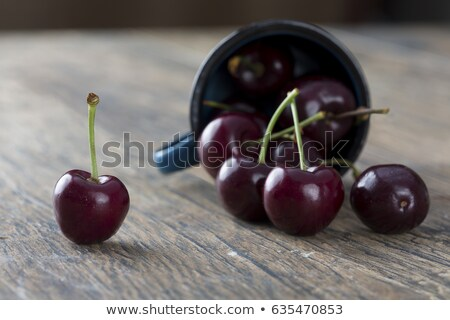 Juicy ruby red cherries in a blue cup Stock photo © Armisael