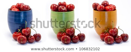 Juicy ruby red cherries in blue, green and orange cups Stock photo © Armisael
