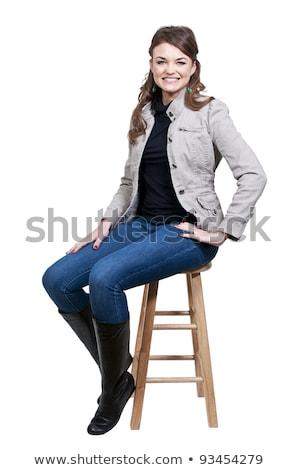 Glamourous woman sitting on stool stock photo © stockyimages