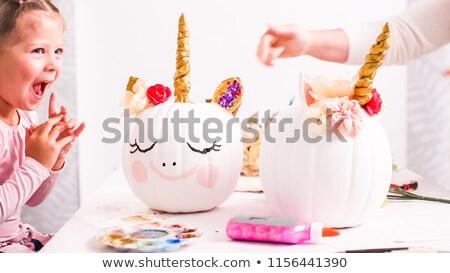 girl decorating pumpkin stock photo © photography33