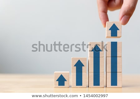 industrial employee stepping up the ladder stock photo © stockyimages