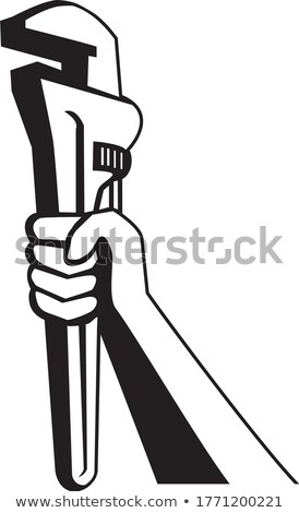 Tradesman holding up a pipe wrench Stock photo © photography33