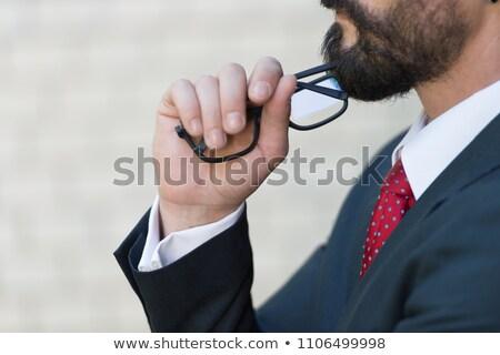 fiatal · üzletember · tart · fekete · szemüveg · fiatalember - stock fotó © photography33