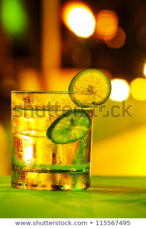 Gin tonic coctail with colorful bokeh. Long exposure shot. Stock photo © moses