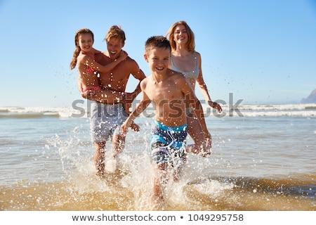 カップル · 愛 · を実行して · ビーチ · 地中海 · 女性 - ストックフォト © wavebreak_media