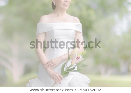 Young happy bride with lilly flowers Stock photo © rosipro