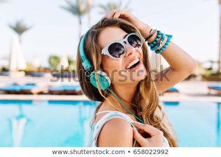 Güzel genç kadın poz havuz tropikal başvurmak Stok fotoğraf © luckyraccoon