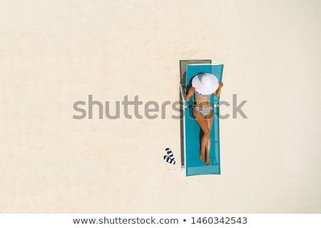 girl on a sun lounger Stock photo © cookelma