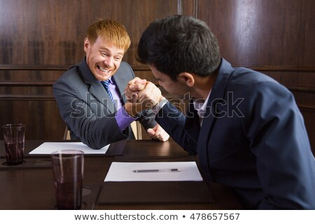 handsome businessmen arm wrestling Stock photo © photography33