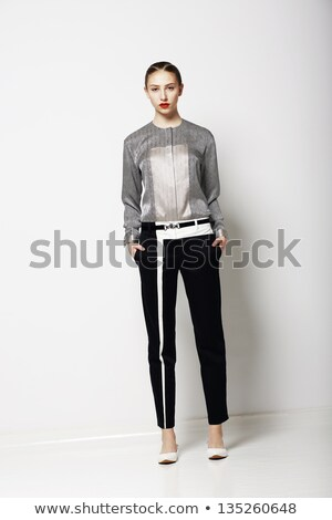 Attitude. Glamor. Fashion Model in Modern Grey Costume. Spring Time Collection. Trend Stock photo © gromovataya
