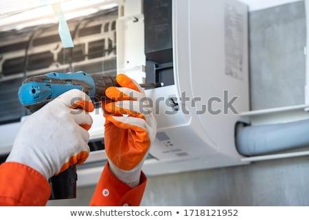 légkondicionálás · javítás · fiatal · szerelő · megjavít · igazi - stock fotó © javiercorrea15