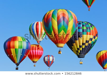 Colorful hot air balloons against blue sky Stock photo © tungphoto