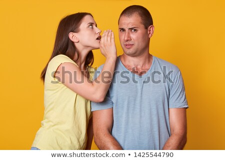Closeup portrait of a cute young woman whispering in her husband Stock photo © dacasdo