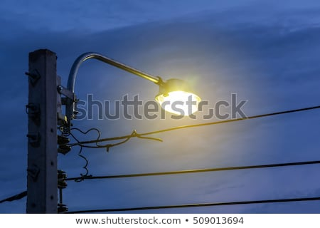 electric high voltage post in night sky Stock photo © tungphoto