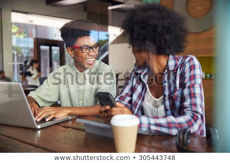 woman in internet cafe Stock photo © ssuaphoto