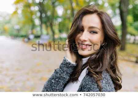 pretty woman holding hands near her face stock photo © nenetus