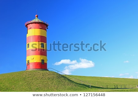 Historical Lighthouse at the North Sea in Germany`s Pilsum. Stock photo © richardjary