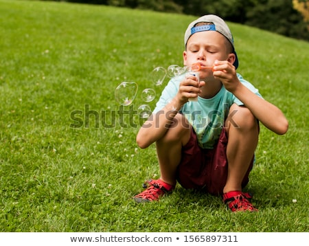Photo stock: Girl Makes Soap Bubbles