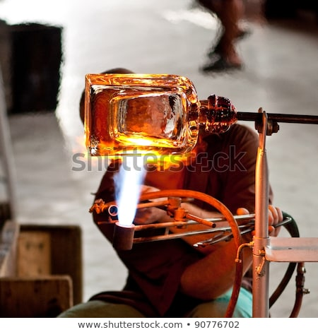 glass blower carefully making his product stock photo © wjarek
