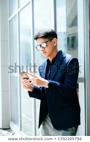 Cool guy with sunglasses challenging Stock photo © feedough