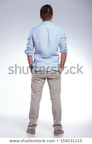 casual young man with both hands in pockets Stock photo © feedough