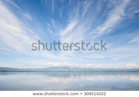 Mountains and sky with clouds. Wide angle view. Stock photo © BSANI