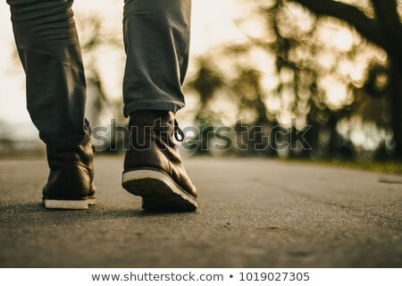 casual fashion man walking in the park stock photo © feedough