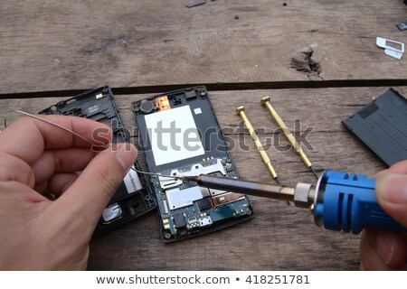 tools and disassembled phone memory card stock photo © OleksandrO