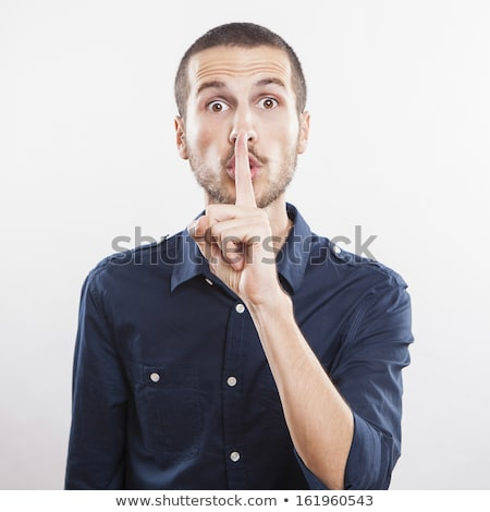 Young man making silence gesture, shhhhh!! Stock photo © deandrobot