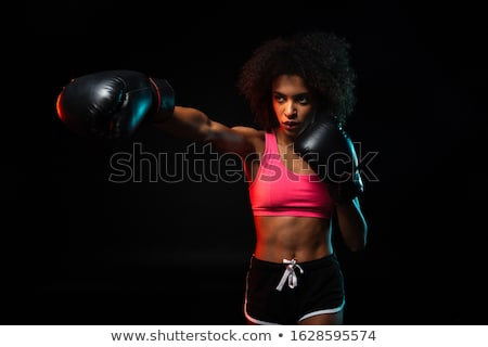 beautiful woman is boxing on black background stock photo © master1305